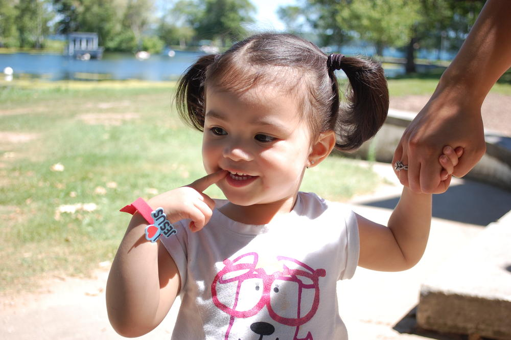 young child with pigtails