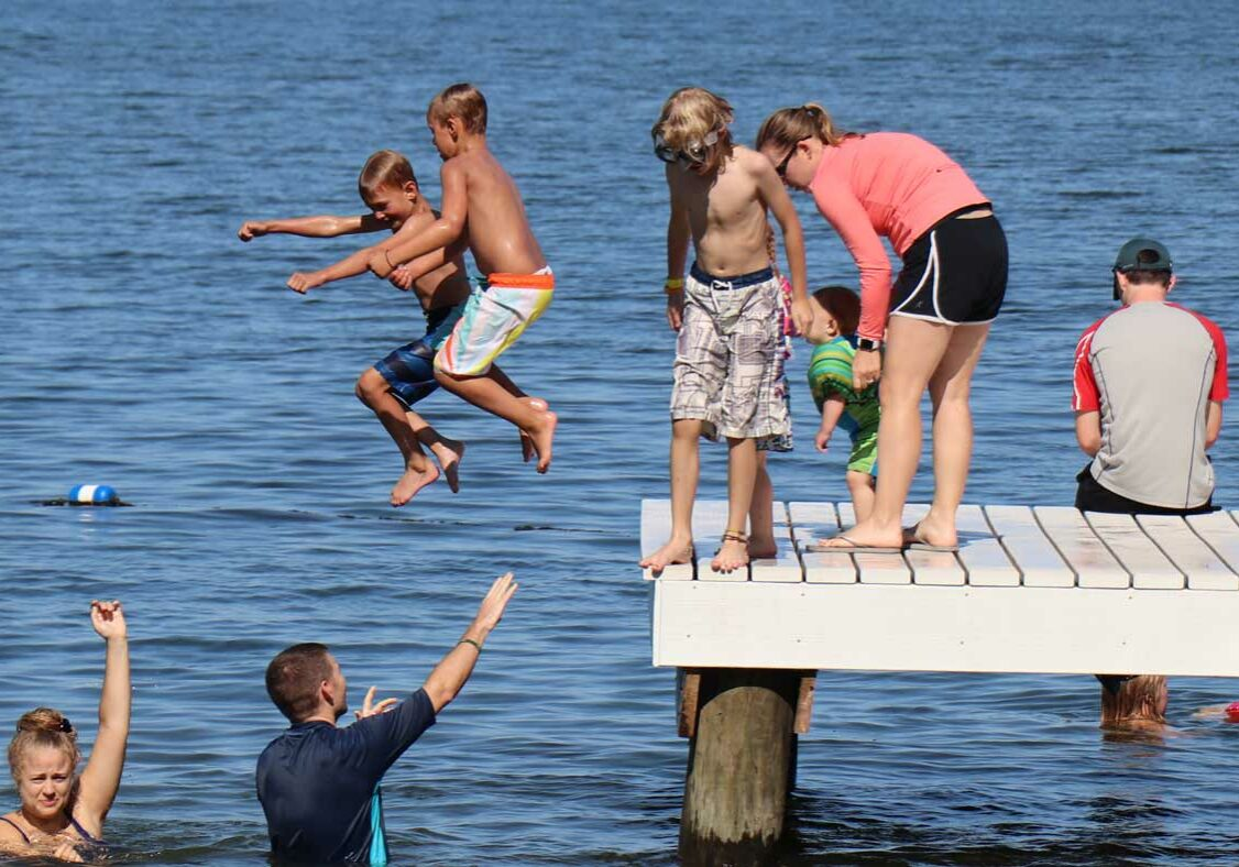 jumping off pier into lake hero
